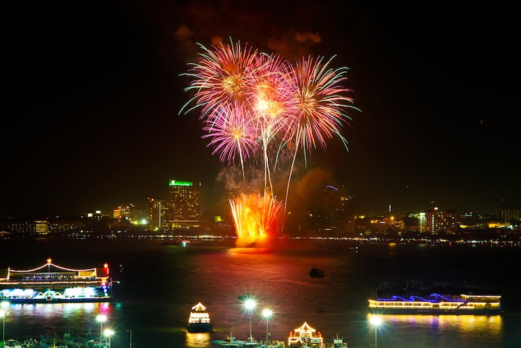 Fireworks with reflections at Pattaya Gulf, Thailand